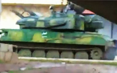 This image from amateur video made available by Shaam News Network, purports to show a Syrian military tank in Daraa, Syria (photo credit: AP/Shaam News Network via APTN