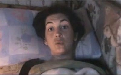 Image from amateur video purports to show Edith Bouvier of Le Figaro in a makeshift clinic in Homs, Syria (photo credit: AP)