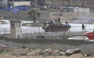 Illustrative photo of a tank rolling through a Syrian city earlier this year. (photo credit: AP)