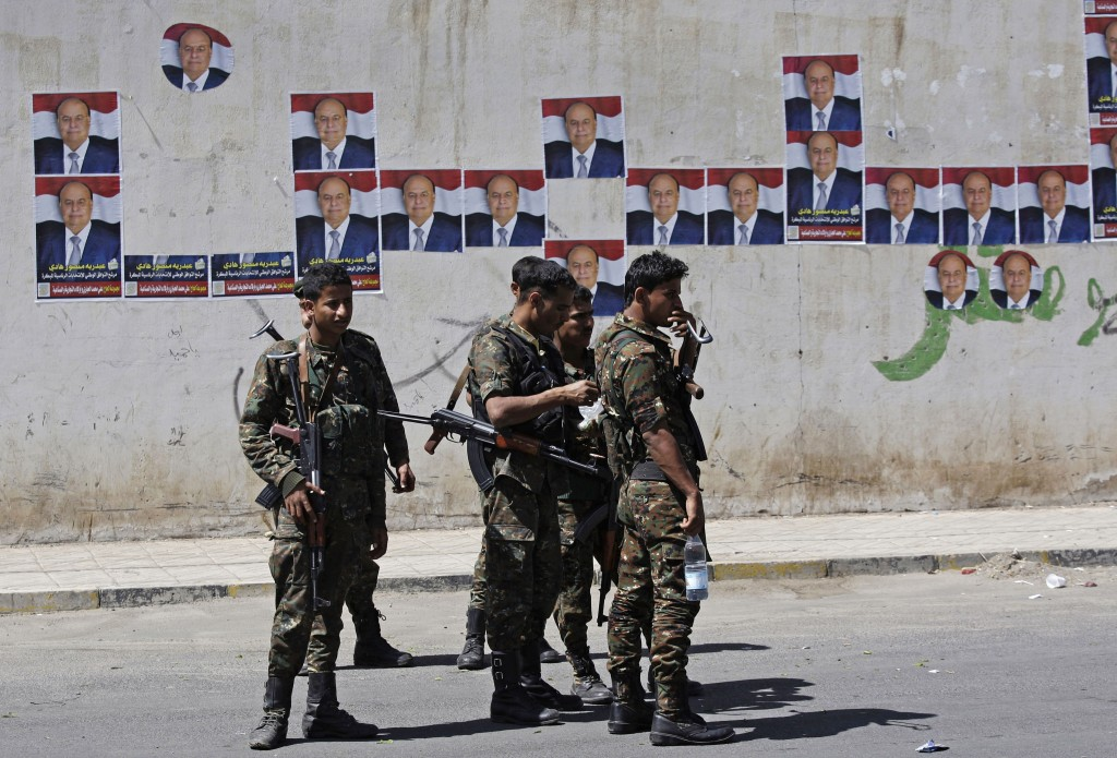 Soldiers stand during a pro-election rally in Sanaa on Monday (photo credit: AP/Hani Mohammed)