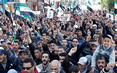 Demonstrators  in Casablanca, Morocco, show solidarity with the Syrian people (photo credit: AP/Abdeljalil Bounhar)