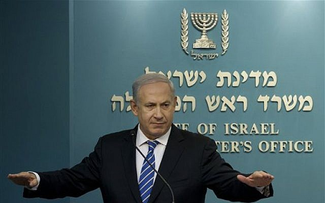 Prime Minister Benjamin Netanyahu speaks at a press conference in his office on Wednesday. (photo credit: AP/Bernat Armangue)