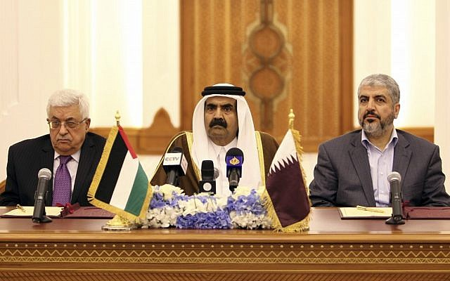 Emir of Qatar Sheikh Hamad Bin Khalifa Al-Thani , center, and Palestinian President Mahmoud Abbas, left, and Hamas leader Khaled Mashaal, right, during the signing of the agreement in Doha, Qatar, on Monday Feb. 6, 2012. (photo credit: AP/Osama Faisal)