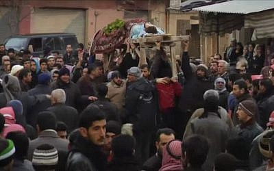 Funeral procession in Homs (photo credit: AP/APTN)