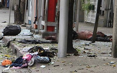 A suspected bomber lies injured at the site of the explosion in Bangkok, February 2012 (photo credit: AP Photo)