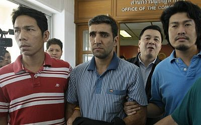 Thai immigration officers escort detained Iranian Mohammad Kharzei (center) at immigration headquarters in Bangkok. (photo credit: AP)