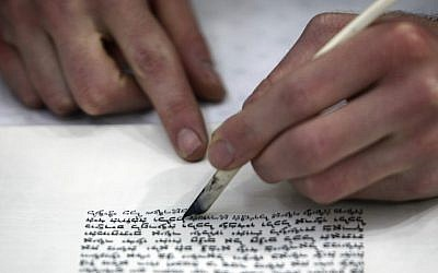Torah scroll being written by hand (photo credit: Nati Shohat/Flash 90).