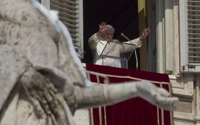 Pope Benedict XVI, framed by a snow topped statue, delivers his blessing at the Vatican, Sunday, Feb. 5, 2012. (photo credit: AP/Andrew Medichini)