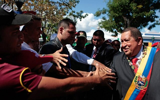 Venezuela's President Hugo Chavez greets supporters (photo credit: AP Photo/Miraflores Press Office)