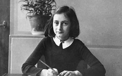 Anne Frank, age twelve, at her school desk in Amsterdam, 1941.