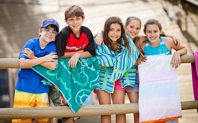 Illustrative photo of campers at Camp Ramah in New England get ready to cool down in the lake during a hot summer day. (photo credit: Nir Landau/Foundation for Jewish Camp via JTA)