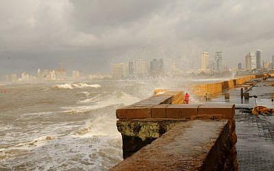 Waves crash against the Jaffa boardwalk as storm hits Israel (photo credit: Tomer Neuberg/Flash90)