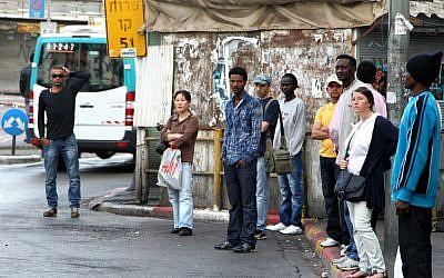 Tel Aviv residents wait for the bus (photo credit: Nicky Kelvin/Flash90)