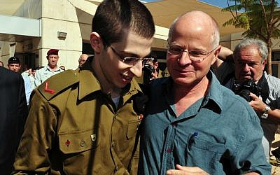 Gilad Shalit with his father, Noam, on the day of his release from captivity (photo credit: Ariel Hermoni/ Defense Ministry/Flash90)