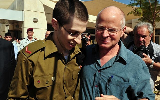 Gilad Shalit with his father Noam, on the day of his release from captivity (photo credit: Ariel Hermoni/ Defense Ministry /Flash90)