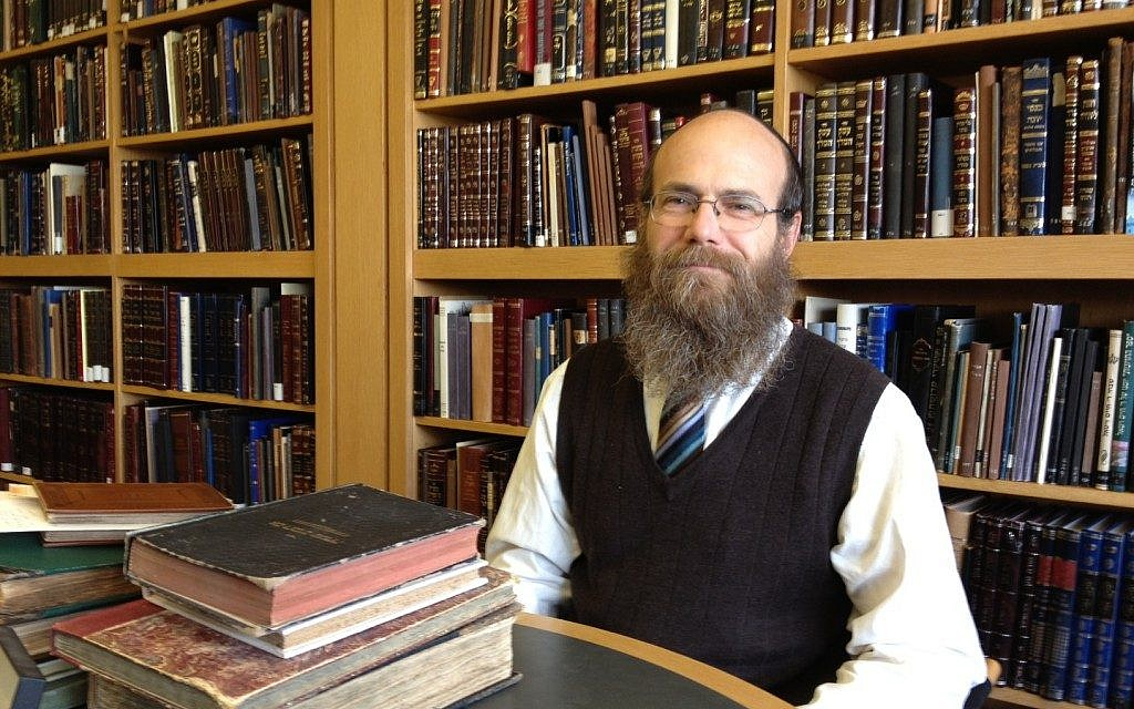 Dr. Zvi Leshem in the Gershom Scholem Library (photo credit: Amanda Borschel-Dan/The Times of Israel)