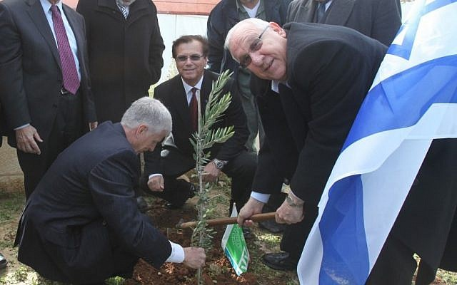 Knesset Speaker Reuven Rivlin (right) on Wednesday planted a young tree in a Jerusalem forest on the occasion of the Jewish holiday of Tu BiShvat (photo credit: Yossi Zamir/Flash90)