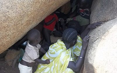 Sudanese villagers use caves as makeshift bomb-shelters from government aerial strikes (photo credit: courtesy)
