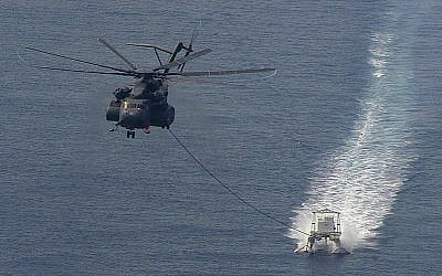 A US helicopter towing a minesweeper in the Persian Gulf in 2006. (photo credit: CC-BY-SA, Marion Doss, Flickr)