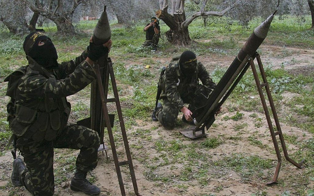 Islamic Jihad members firing rockets into Israel from the Gaza Strip. (photo credit: CC BY-SA Amir Farshad Ebrahimi, Flickr)