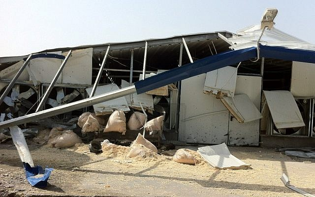 A farm building in southern Israel which was hit directly by a rocket. (photo credit: IDF Spokesman's Office)
