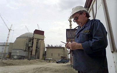A worker outside the Bushehr nuclear power plant in Iran (photo credit: AP/Vahid Salemi)