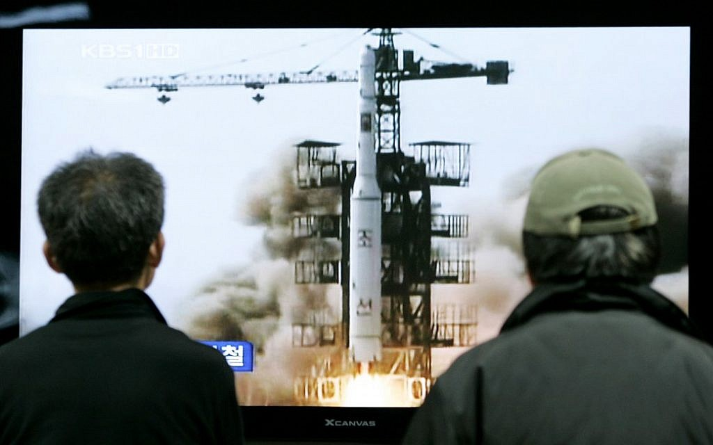 South Koreans watch the 2009 launch of a North Korean missile on TV (photo credit: AP/Ahn Young-joon)