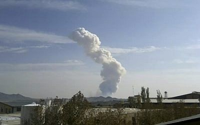 In this image taken from amateur video, smokes rises from an explosion at a Revolutionary Guard ammunition depot outside Bidganeh village, west of Tehran, last November (photo credit: AP)