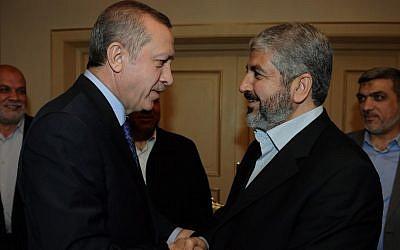 Then Turkish Prime Minister Recep Tayyip Erdogan meets with Hamas leader Khaled Mashaal in 2012. (Yasin Bulbul/AP)