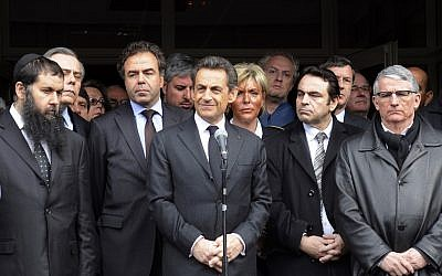 French President Nicolas Sarkozy speaks in front of the Ozar Hatorah Jewish school, alongside France's Education Minister Luc Chatel, second from left, France's Jewish central Consistory Joel Mergui, second from right and Pierre Cohen, mayor of Toulouse, right (photo credit: AP Photo/Eric Cabanis, Pool)