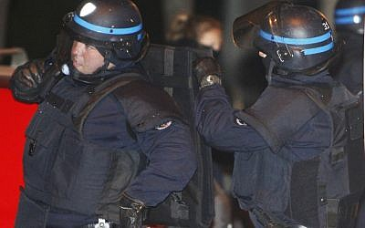 French police outside the apartment of Toulouse shooter Mohamed Merah in March (AP/Remy de la Mauviniere)