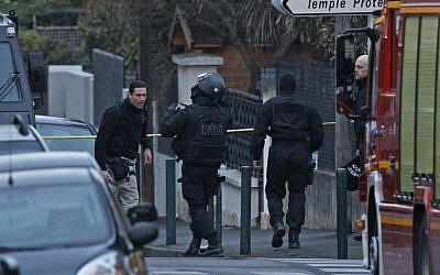 French police outside the apartment of Mohamed Merah on the day he was killed in a gun battle (photo credit: AP/Remy de la Mauviniere)