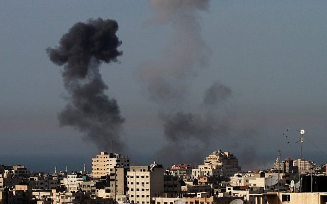 Illustrative photo of an explosion in Gaza City (photo credit: AP/Hatem Moussa)