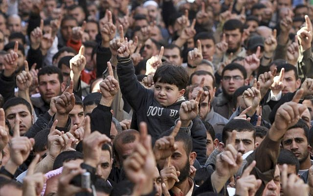 Palestinians rallying in Jabaliya Refugee Camp, demanding Egypt provide the Gaza Strip with electricity and diesel (photo credit: AP/Hatem Moussa)