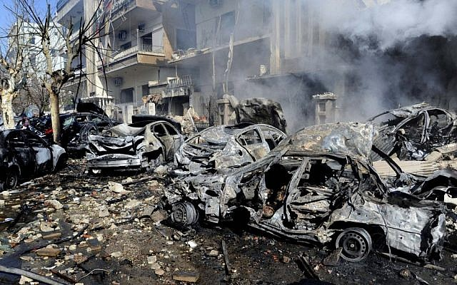 Burnt and destroyed cars are seen near the aviation intelligence department, which was attacked by one of two explosions in Damascus, Syria, March 17, 2012. (photo credit: AP Photo/SANA)