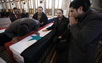 The funeral of Damascus bombing victims Sunday (photo credit: AP/Muzaffar Salman)