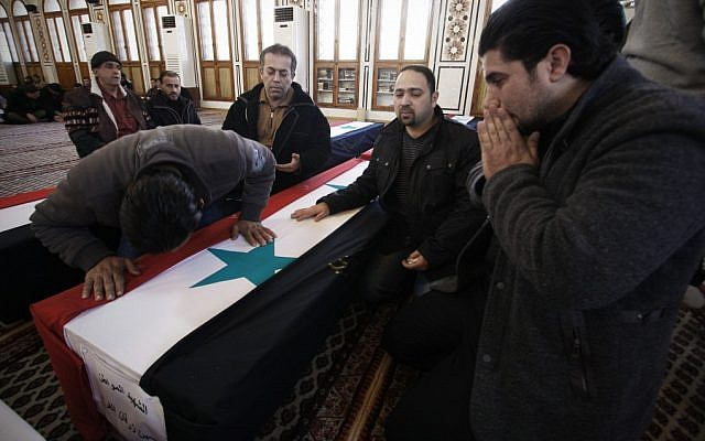 The funeral of Damascus bombing victims Sunday (photo credit: AP/Muzaffar Salman)