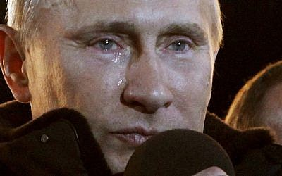 Russian Prime Minister Vladimir Putin, who claimed victory in Russia's presidential election, tears up as he reacts at a massive rally of his supporters at Manezh square outside Kremlin, in Moscow, Sunday. (photo credit: AP/Ivan Sekretarev)