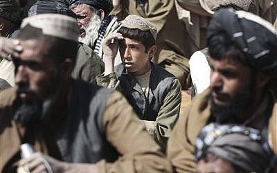 Afghan villagers pray for the victims in Kandahar (photo credit: AP/Allauddin Khan)