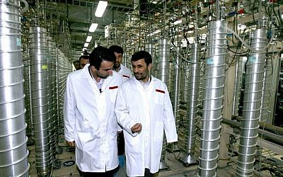 File photo of Iranian President Mahmoud Ahmadinejad visiting the uranium enrichment facility at Natanz in 2008. (photo credit: AP/Iranian President's office, File)