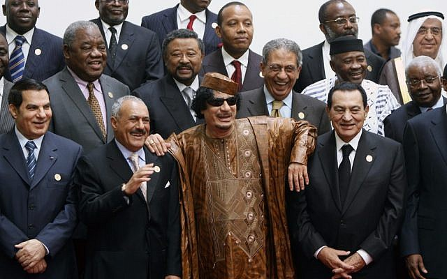 Libyan leader Muammar Gaddafi, center, flanked on his right by Egyptian President Hosni Mubarak, and on his left by Yemeni President Ali Abdullah Saleh, with Tunisian President Zine El Abidine Ben Ali on the far left, posing during the second Afro-Arab summit in Sirte, Libya, in 2010 (photo credit: AP/Amr Nabil)