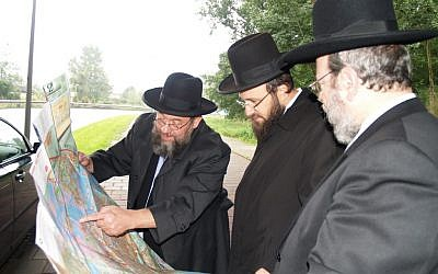 Amsterdam's Chief Rabbi Aryeh Ralbag, left, with members of Amsterdam's rabbinate. (David Serphos/JTA)