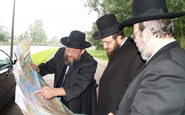Amsterdam's Chief Rabbi Aryeh Ralbag, left, with members of Amsterdam's rabbinate. (photo credit: David Serphos/JTA)