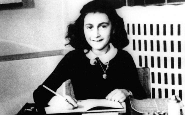 Anne Frank, age 12, at her school desk in Amsterdam in 1941. (AP Photo)