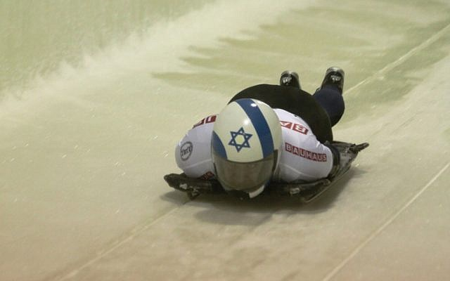 Skeleton competitor Bradley Chalupski, representing Israel, starts down the track at the men's world championships in Lake Placid, NY, February 24, 2012. (Photo credit: Ken Childs/JTA)