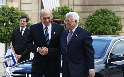 Former prime minister Ehud Olmert meets with Palestinian Authority President Mahmoud Abbas in Paris in 2008 (photo credit: Thaer Ganaim/Flash90)