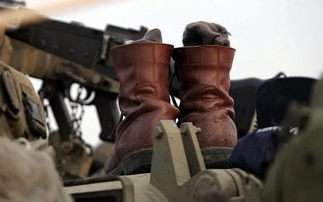 IDF boots on a tank during Operation Cast Lead (photo credit: Nati Shohat/Flash 90)