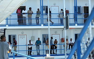 Sudanese refugees in the courtyard of Ketziot Prison detention camp in 2009 (photo credit: Moshe Shai/Flash90)