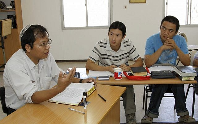 One can adopt a theology, but it is far more difficult to adopt a history. Young Chinese men study Torah to prepare for their Orthodox conversion (photo credit: Gershon Elinson/Flash90)