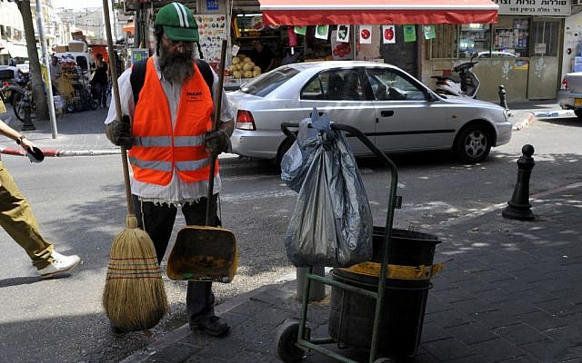 An ultra-Orthodox Israeli works as a street cleaner. A new study says more ultra-Orthodox men are joining the workforce (photo credit: Serge Attal/Flash 90)